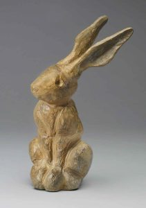 A bronze rabbit with a carved wood looking patina